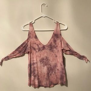 Purple-pink tie dye shirt that ties at the arms.